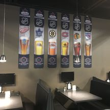seating booth with beers banners hanging